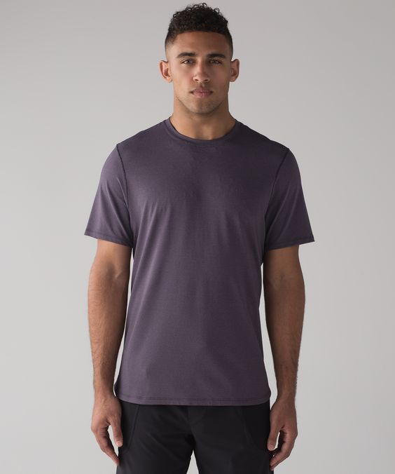 Anti-stink mesh tee is treated with flat seams and split hem for mobility