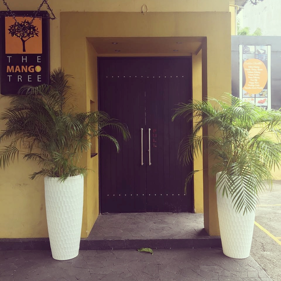 The Mango Tree restaurant in Colombo with illuminated Sereno planters at their entrance