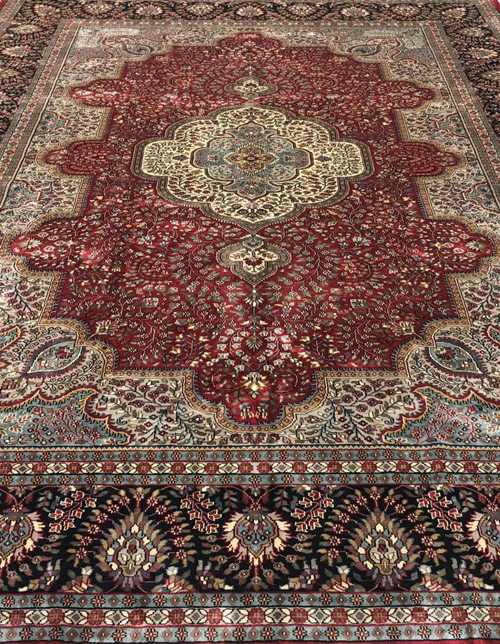 ORIENTAL RUGS:   Hand knotted traditional rugs