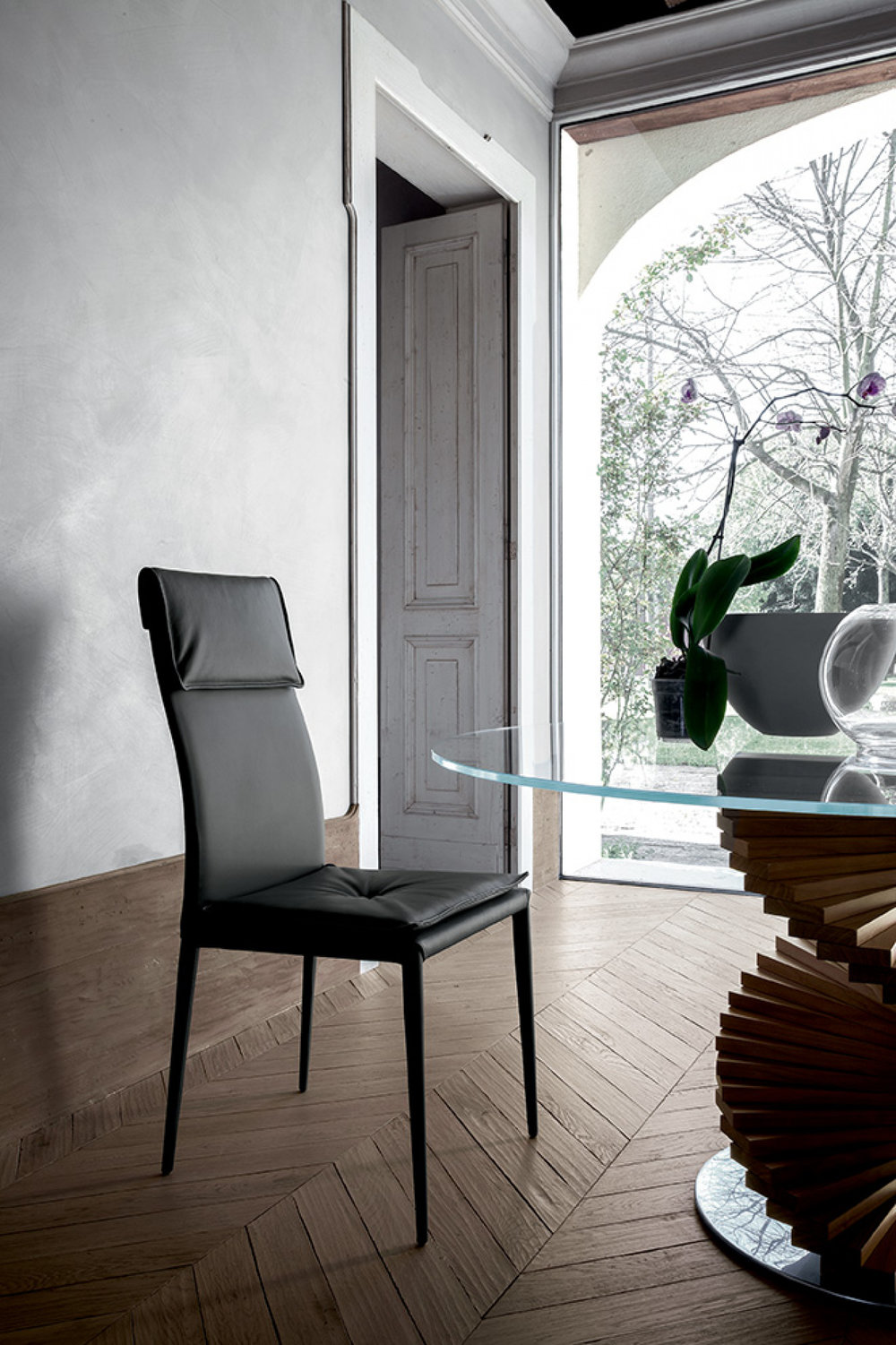 Indulge in elegance - Made in Italy by Tonin Casa, this chair with its simple yet refined elements creates an overall look that says 'sophisticated with a twist'.
