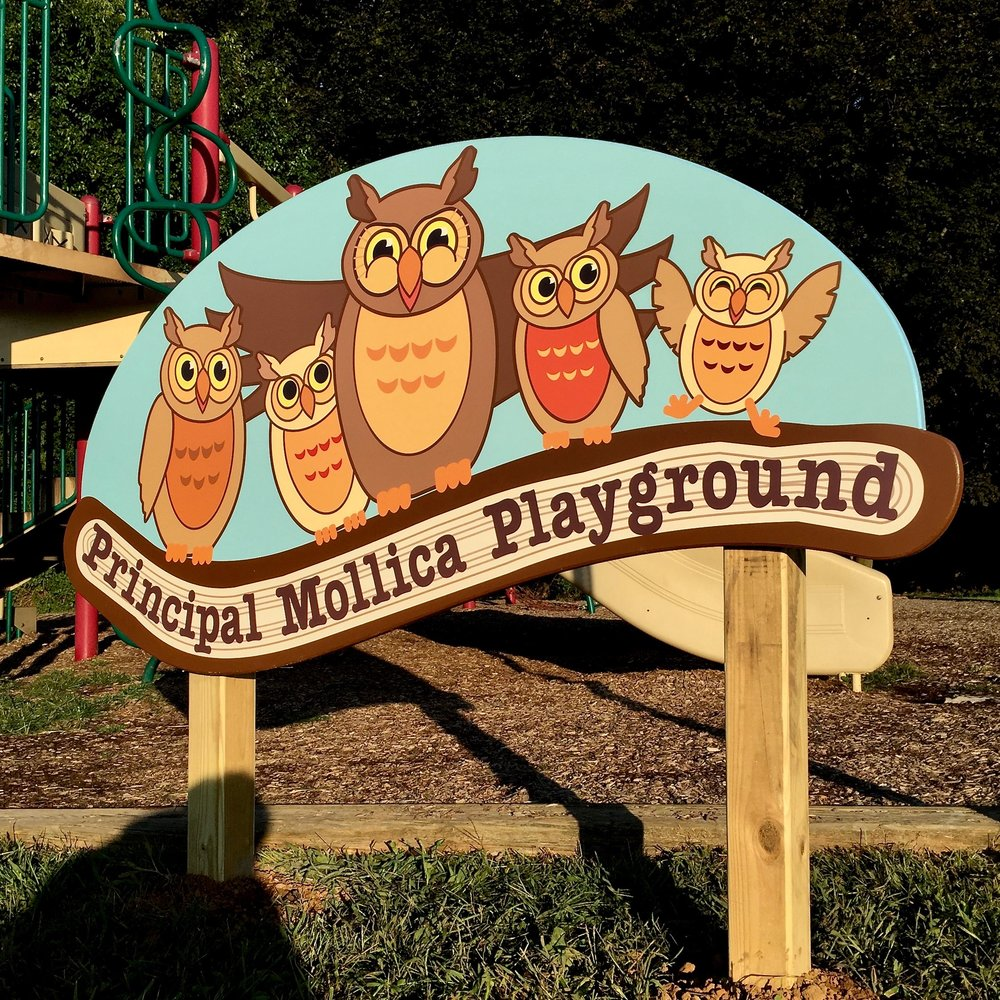 Last year we were asked to develop a new sign for the front entrance of Cedar Hill School in Basking Ridge replacing an old faded and torn banner. We worked with Principal Mollica to develop it,  but unfortunately he retired before the funding was approved and the sign was installed. This year the school board decided to honor Mr. Mollica by naming the playground after him and we used the same owl branding that we developed with his guidance for this great looking hand crafted sign.