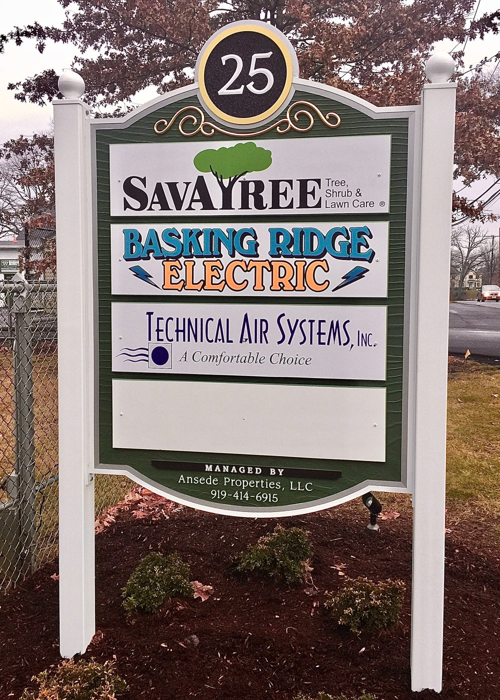 This hand crafted Industrial Park Sign in upscale Basking Ridge is just  what this facility needed. This solid PVC sign features a carved woodgrain background giving it the warmth of a wood sign with the weather resistance of PVC. Behind the address is a background of sparkling crushed black glass with a 23K gold leaf prismatic flourish that really sparkles in the sunlight.