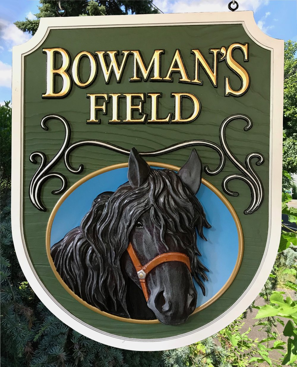 Today we finished a sign for a great customer and lover of Friesian horses. This custom carved sign was created for his farm in Jackson NJ. I features a 3d sculpted horse against a recessed dish for extra dimentionality. The raised prismatic lettering is 23K gold leaf against a faux woodgrain background. It is carved from High Density Urethane for long lasting beauty.