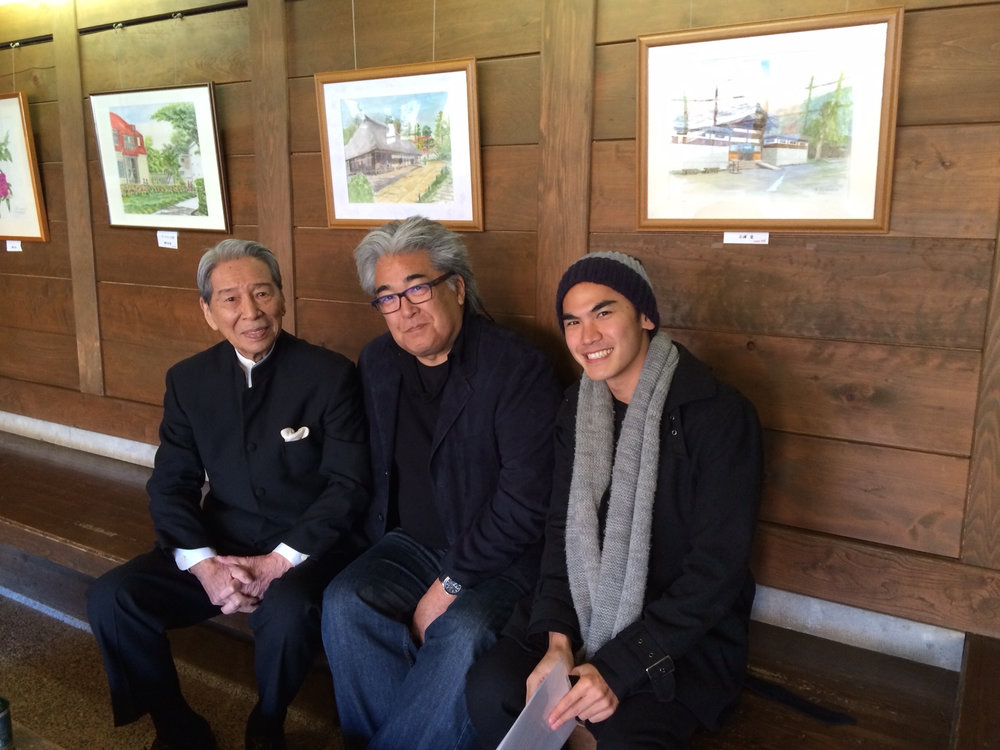 """December 15, 2014 The dashing Yosuke Natsuki (with me and Rikiya Mifune on a cold day in Tokyo) is one of Japanese cinema's legends. He had a small part in YOJIMBO as the disgruntled son in the film's first scene, then starred in hundreds of Toho movies and tv shows, including CHUSHINGURA (1962),GHIDORAH, THE THREE-HEADED MONSTER (1964), SHOGUN (1980) and THE RETURN OF GODZILLA(1984). He talked about working with Kurosawa for the first time, how the famously demanding director made him rehearse the same scene thirty-five times, but still wasn't satisfied and sent the cast and crew home for the day.Deflated and confused, he was leaving the set when Mifune came up behind him and said: """"Remember the name of this film, Yo-shim-bo, which means 'Patience required.' All you can do is be patient and do your best."""" The next day, he says he got the scene in one take, doing it exactly as he did it the day before."""