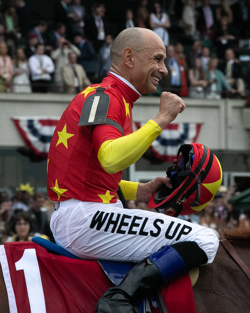 Jockey Mike Smith celebrates after winning the Belmont Stakes.