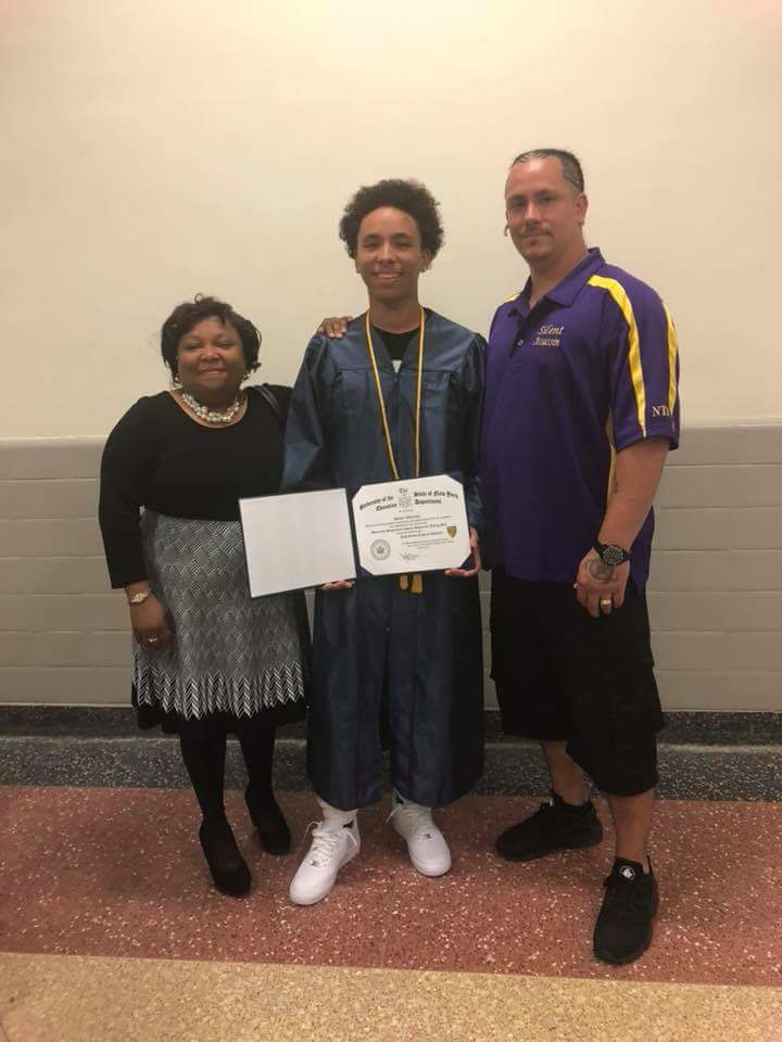The graduate and his proud parents!