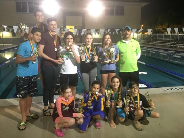 End of year team awards. (   Awards for finishing top ten in championship meets)    From left to right standing Sebastian,Jonny back, Joseph, Rogerlio,Sidney, Melanie   Front row from L to R:   Angelina , Paola Negrin,   George and Paola Gonzalez.