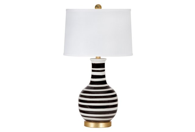 A lamp from OKL that is sure to be a show stopper and give your space a little something special.  Don't be bashful when accessorizing.  Make a statement and let your favorite colors shine!