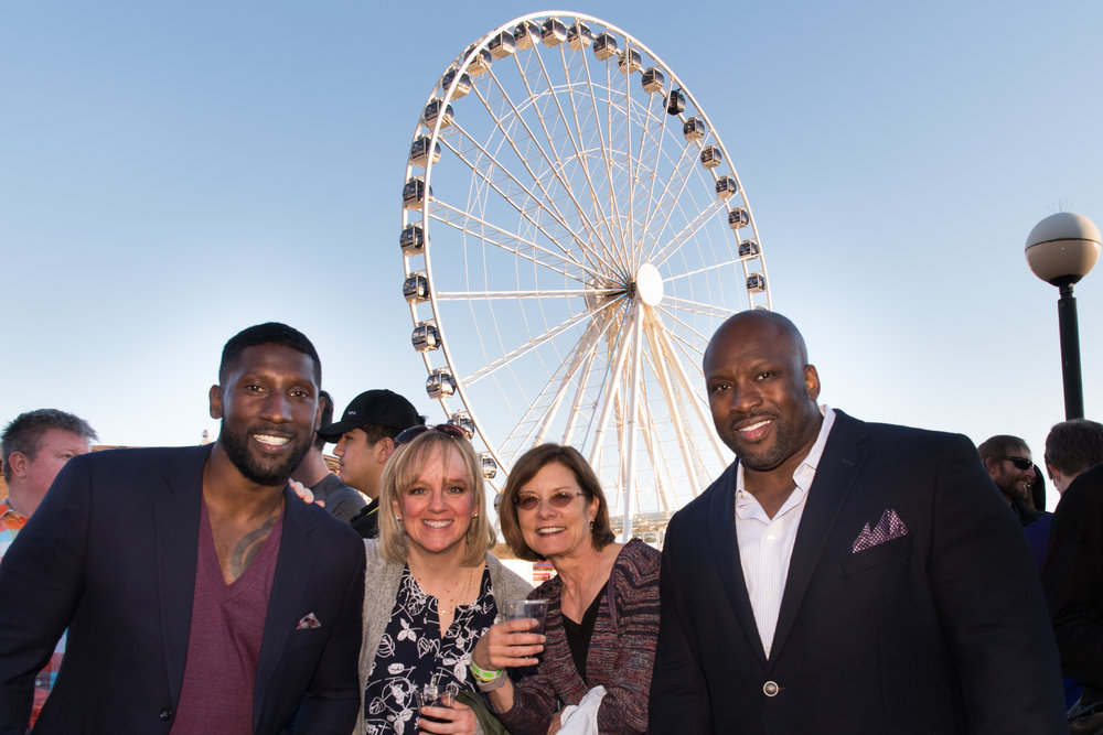 seattle seahawks legend marcus trufant and radio co-host terry holliman with guests at the party.