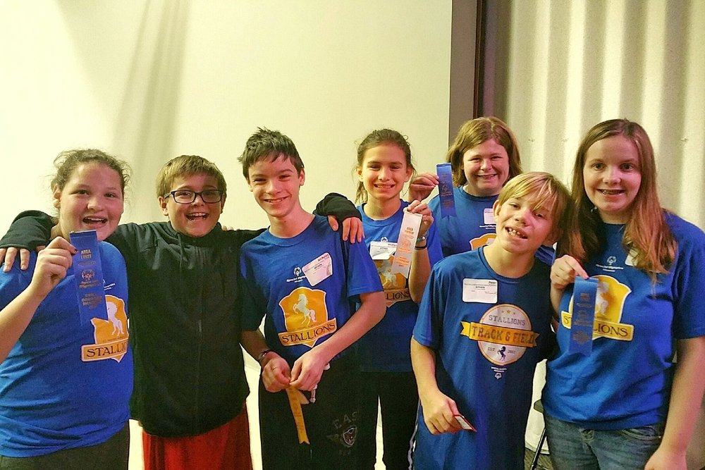 Carson pictured with several of his Special Olympics teammates and friends.