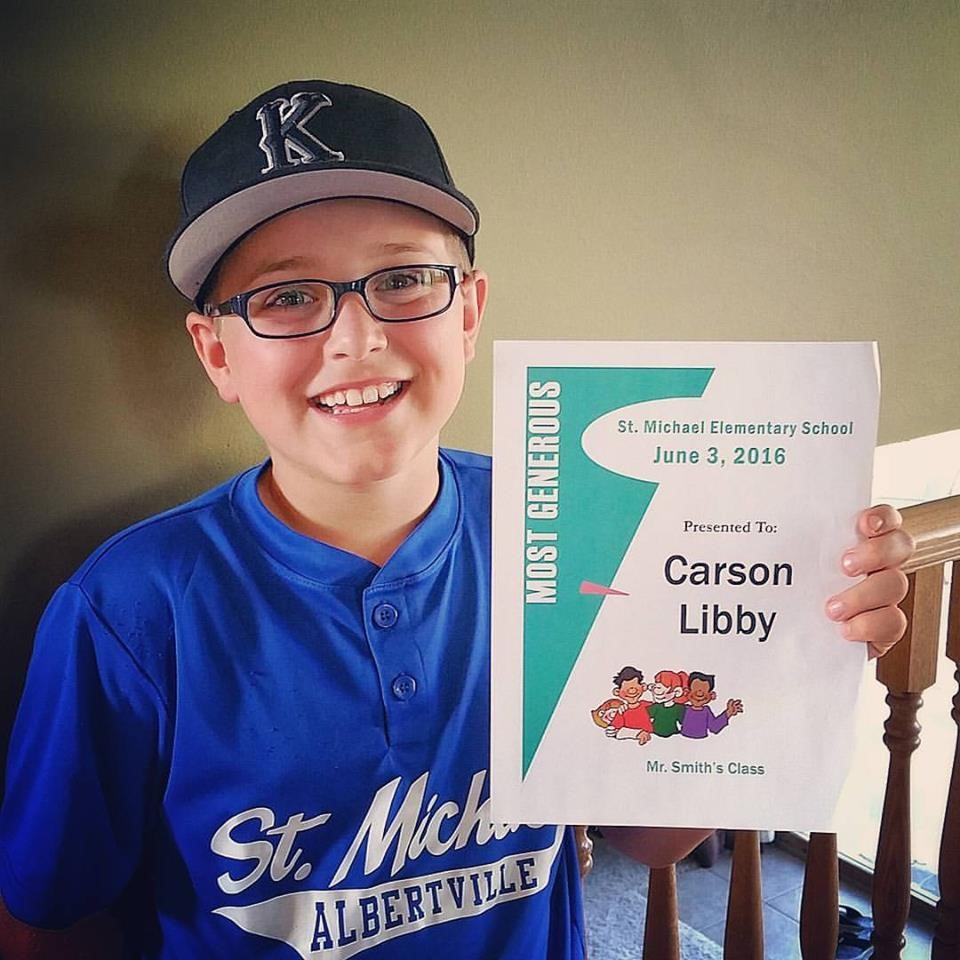 "Carson celebrating his ""Most Generous"" recognition from St. Michael Elementary School."