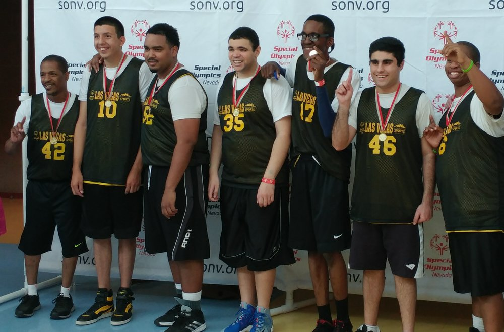 Paul (center) with his Special Olympics basketball team.