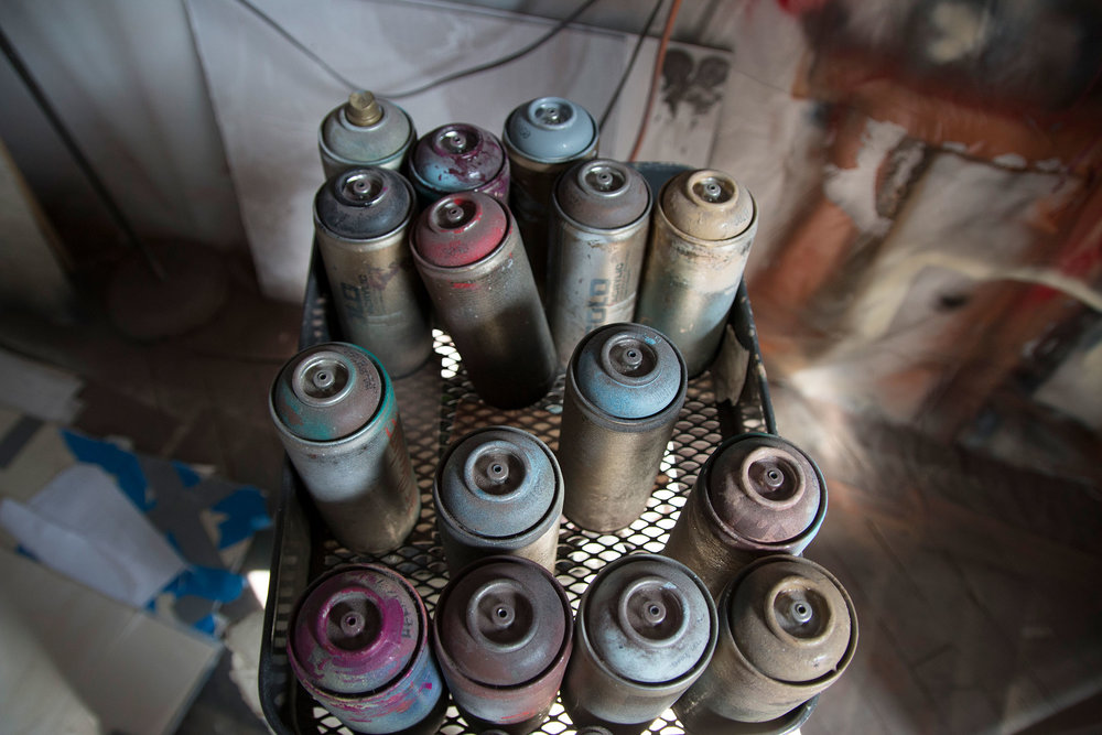 Spray cans and canvas in B.D. White's studio.