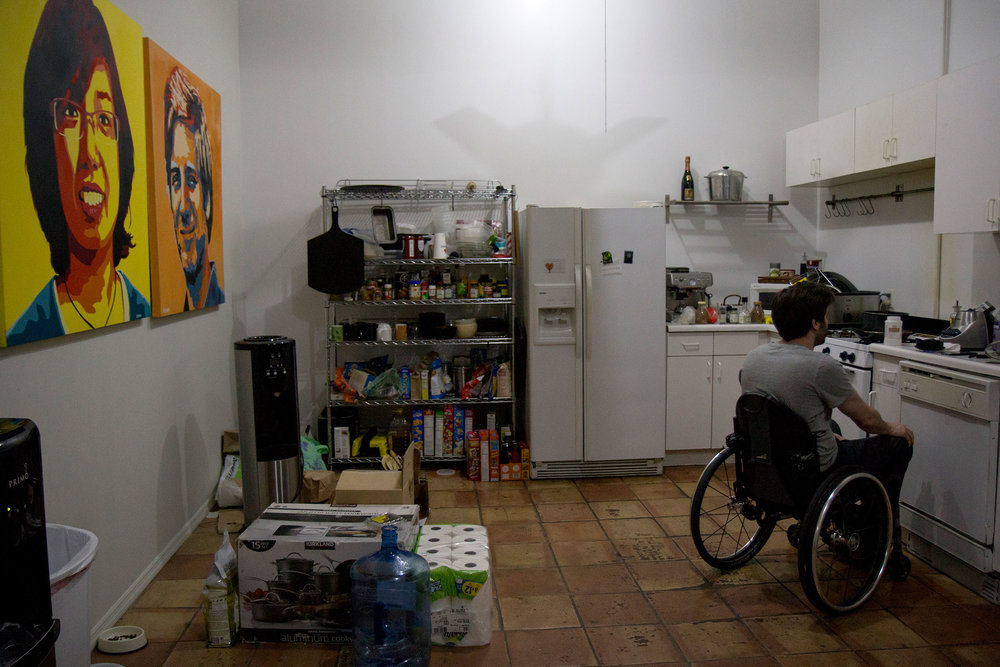 B.D. White blends some wheat paste glue in the kitchen of his studio.