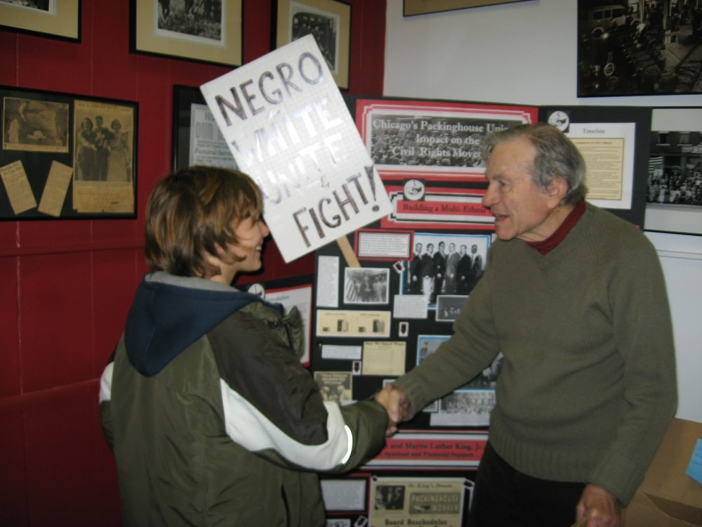 ILHS Co-founder Les Orear congratulates a student on his History Fair display.