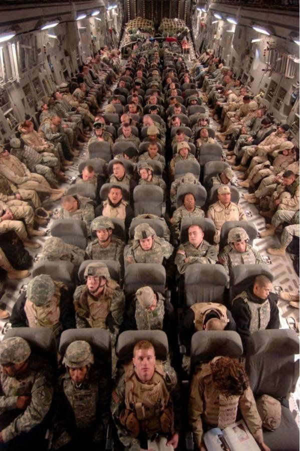 This is how packed it felt! Except we weren't heroes returning from fighting for our country. I was a hero on the plane though when I ripped the stinkiest silent but deadly fart 🙊   Luckily it was a short flight so people didn't have to smell the fart for too long