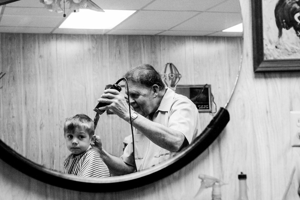 boy-Getting-haircut-by-barber-Lisa-howeler