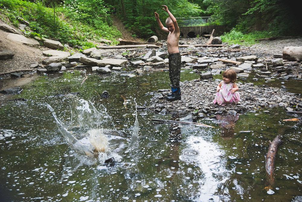 Child-throwing-rock-creek-Lisa-howeler