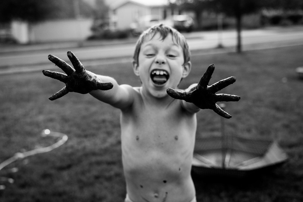 boy-covered-in-mud-Lisa-howeler