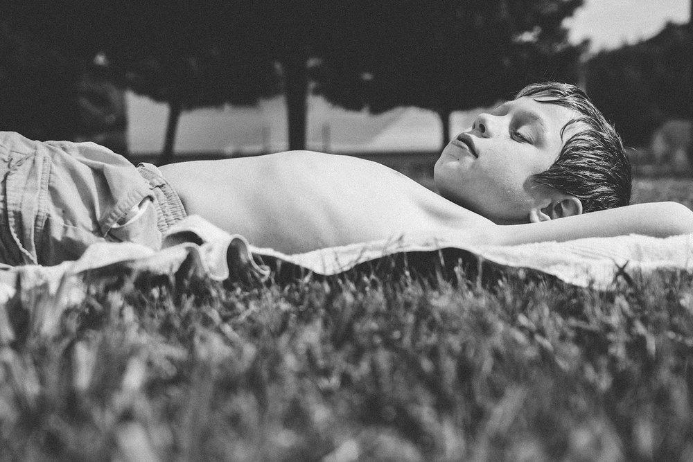 boy-laying-in-sun-Lisahoweler.jpg