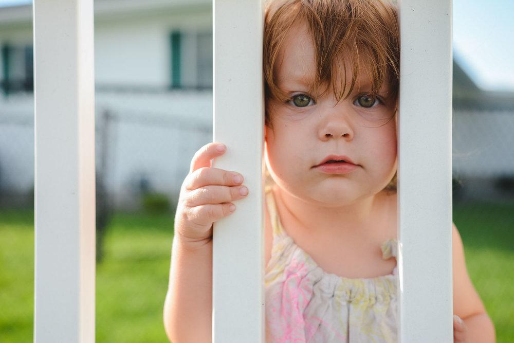 toddler-girl-fence-lisahoweler-copyrighted