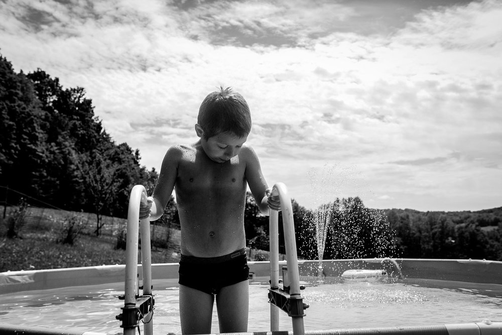 boy-pool-summer-lisa-howeler