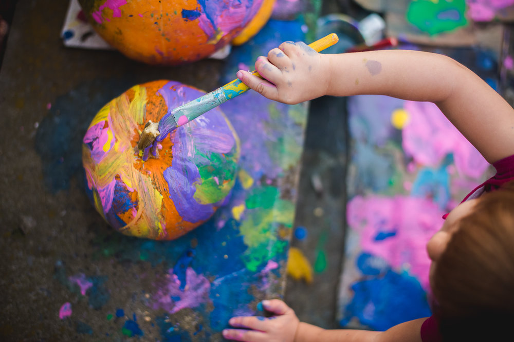 Lisa R. Howeler children painting pumpkins