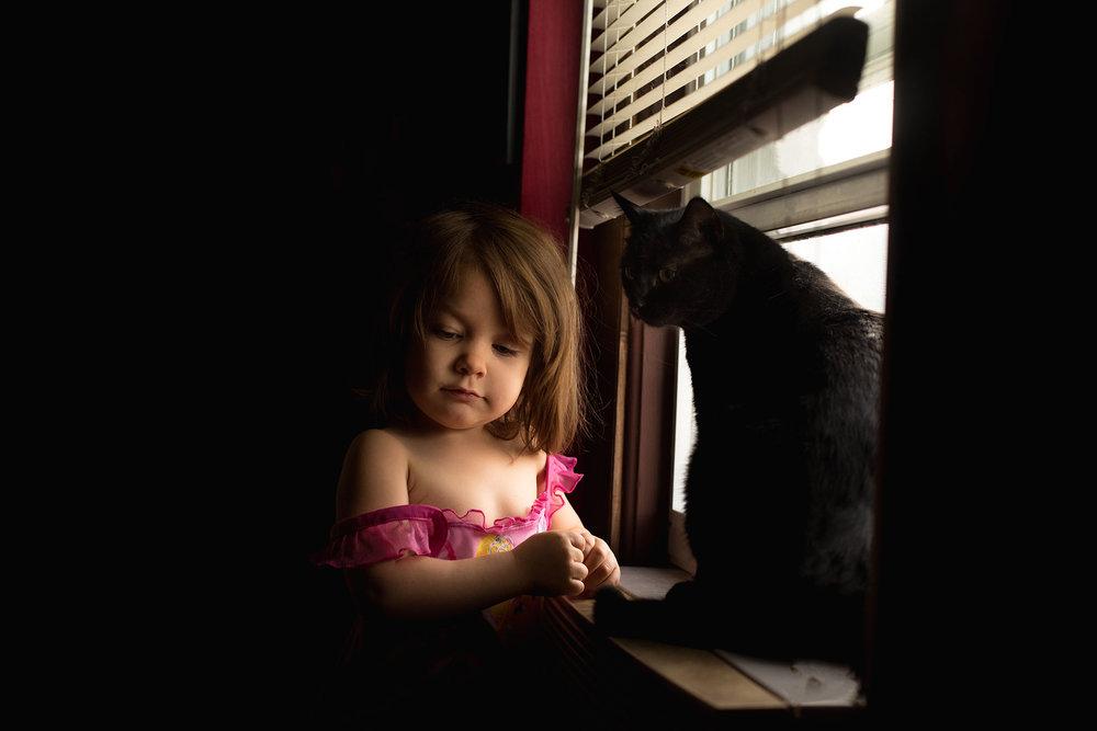 girl and cat copyright Lisa R. Howeler