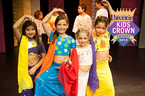 happy kids pose in colorful acting costumes.