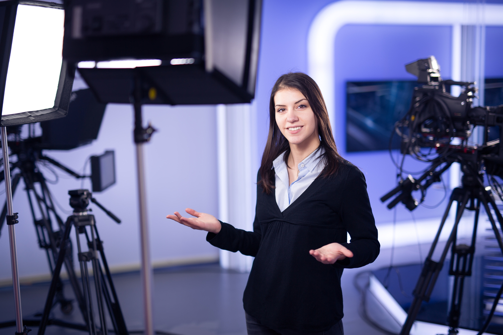 a girl smiles in a tv studio