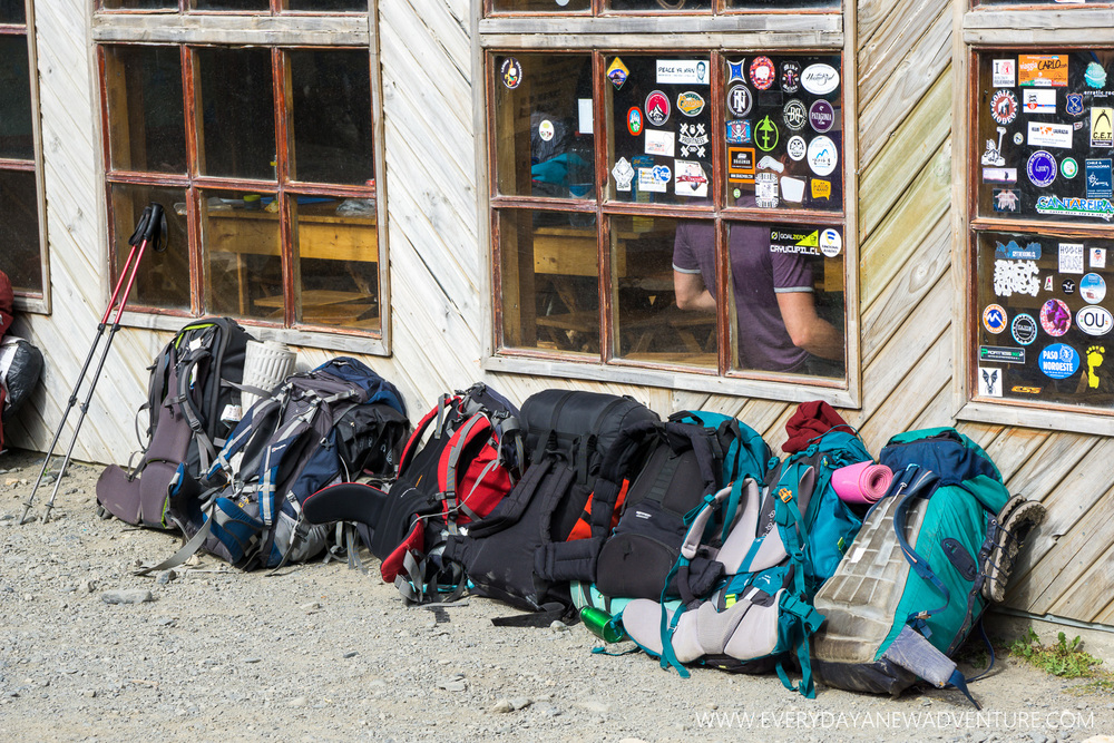 Backpacks lined the outside of the dining hall at Chileno.