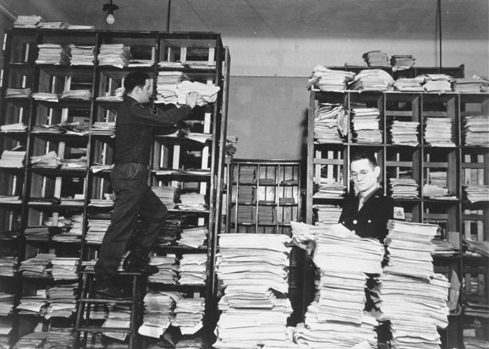 Stacks of German documents collected by war crimes investigators as evidence.  US Holocaust Memorial Museum, courtesy of National Archives and Records Administration, College Park, MD