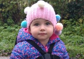 Saffron in her Pom Pom Hat