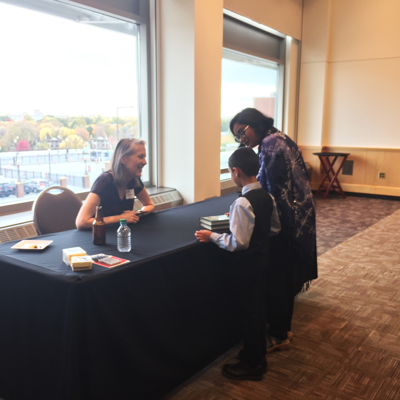 Mary Roach talking with a young reader.