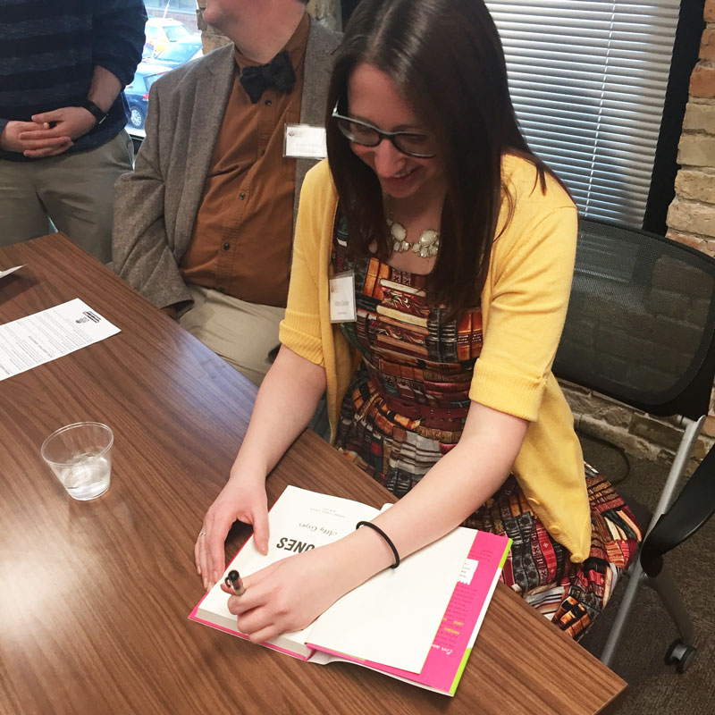 "Abby Cooper signing  ""Sticks & Stones."""