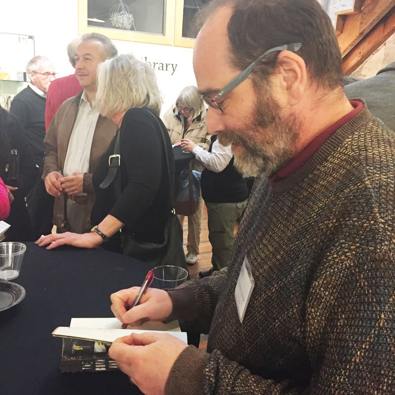 "Robert Spande signing  ""The Born and the Made."""