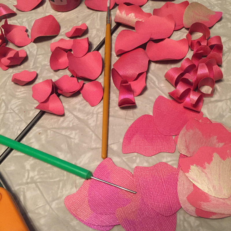 Making the flowers was the most time intensive part. The two flowers took hours with the cutting, painting, and curling, and then glueing together.