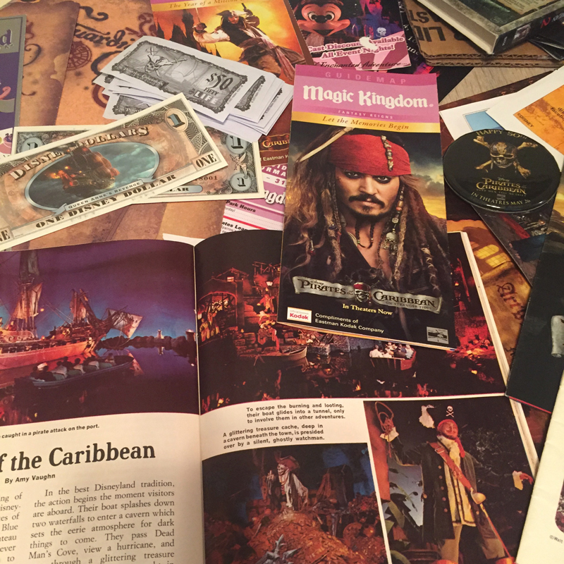In this image you can see Pirates themed Disney Dollars, a Park Map for the Magic Kingdom, a magazine spread from a vintage Jack & Jill magazine, a 50th anniversary pin, and more.