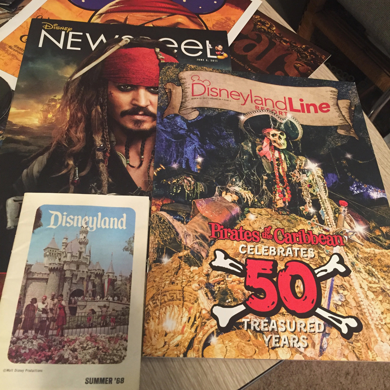 In this image you can see a Disneyland brochure from 1968 and some cast member internal magazines featuring Pirates.