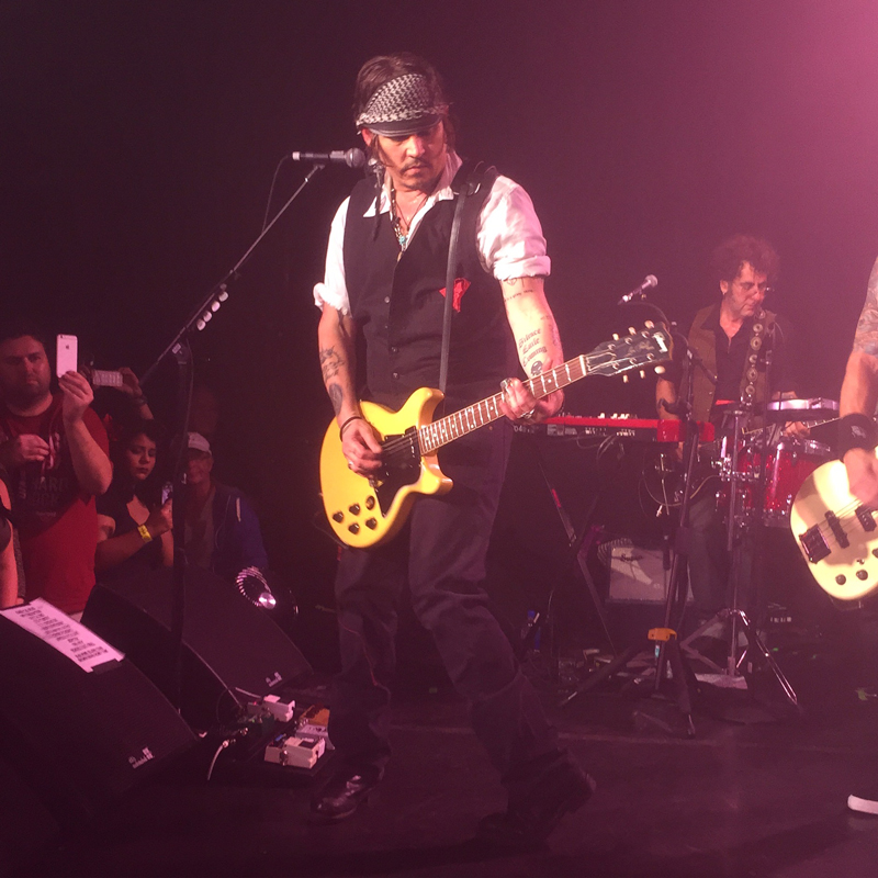 Johnny Depp playing at the Roxy in LA.