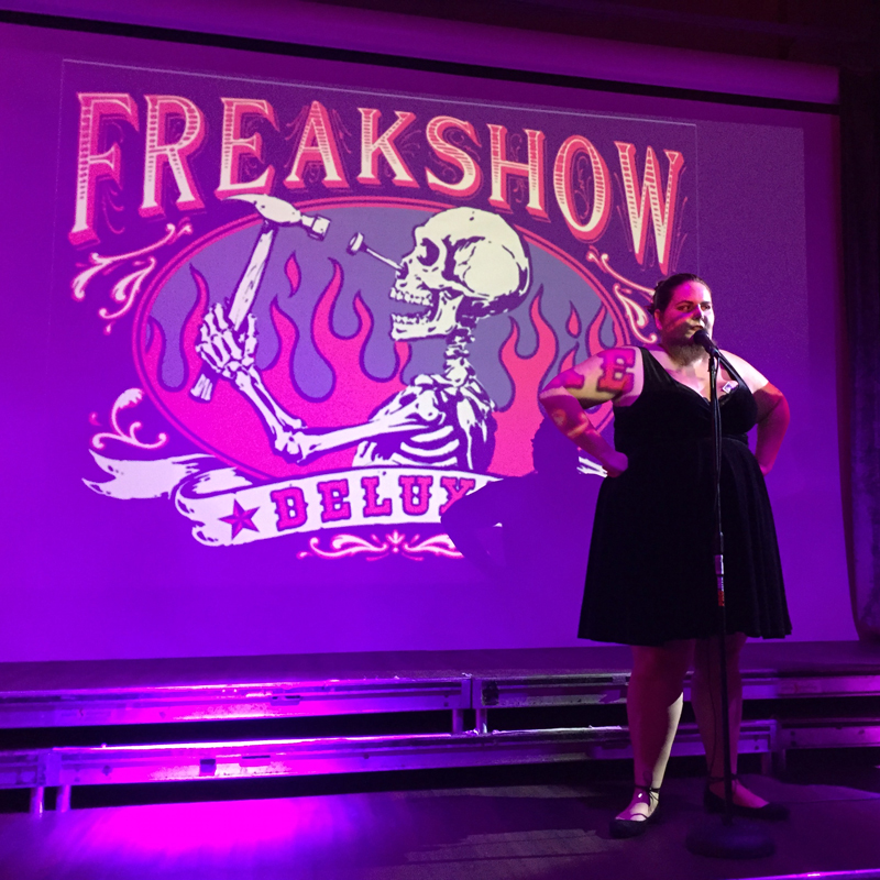 Dinner and a show starts off with a freak show act featuring a bearded lady.