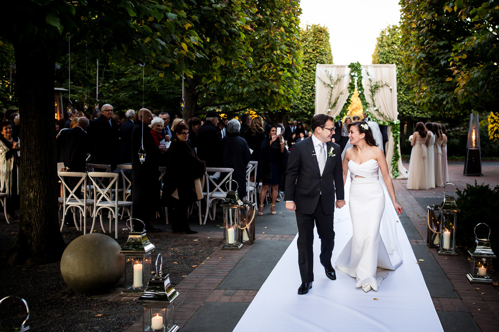 Walking down the aisle at real wedding at Chicago Botanic Garden