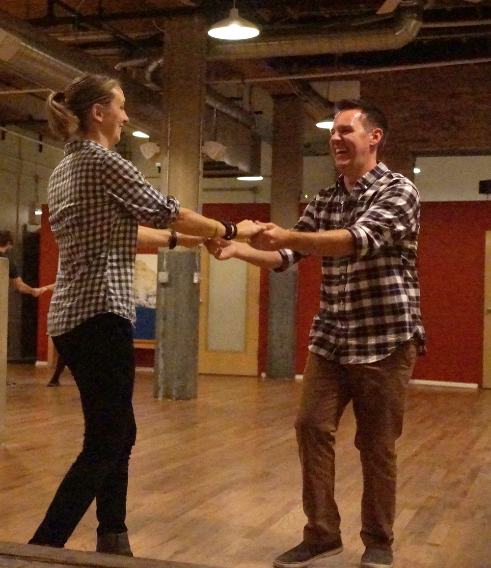 A couple having fun during a private dance lesson with Ballroom Dance Chicago