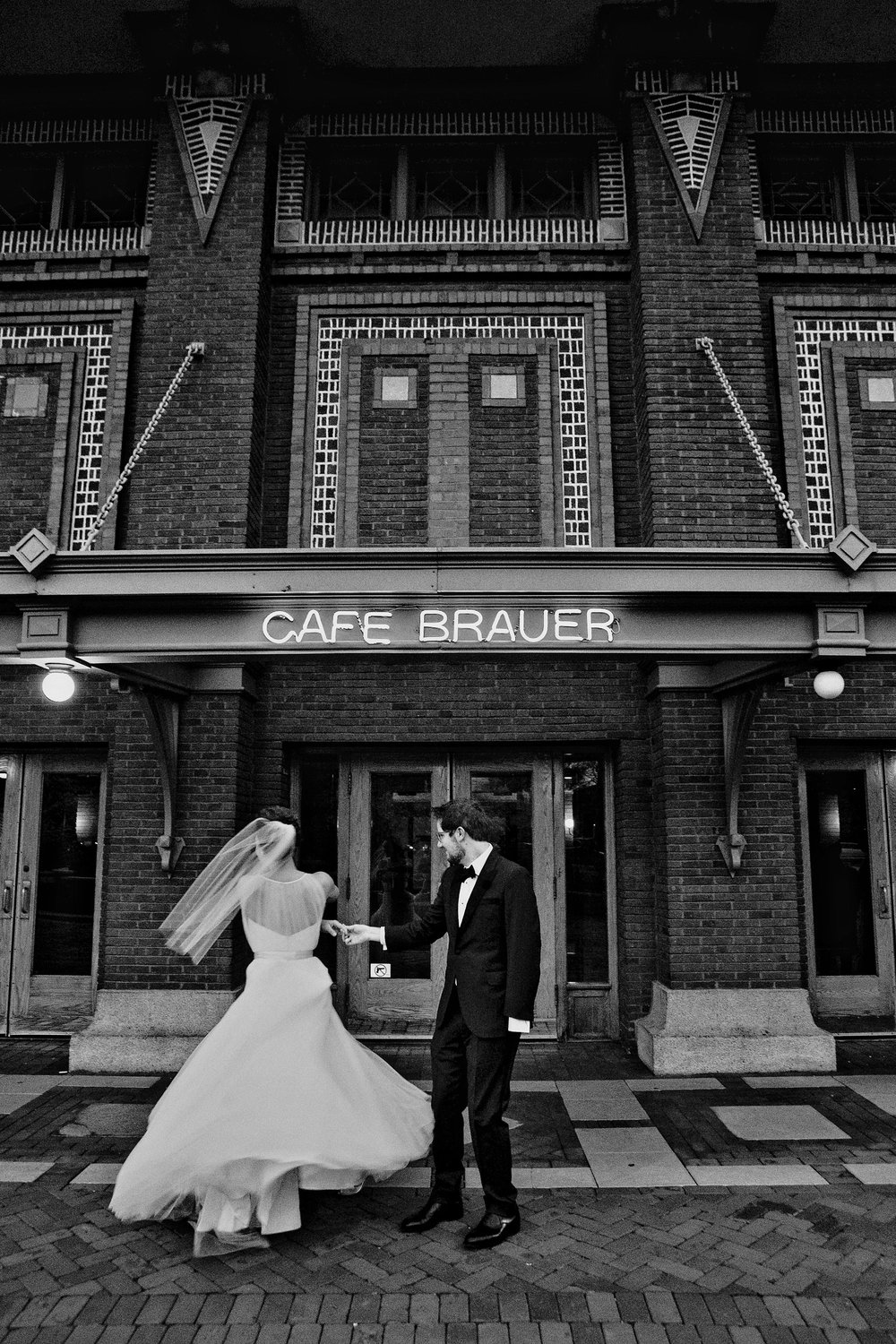 Couple spinning in front of Cafe Brauer