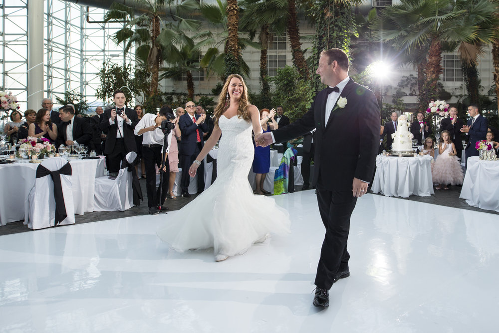 A couple walking out on to the dance floor