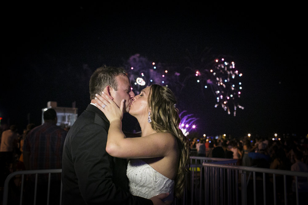 Couple kissing at their wedding on Navy Pier