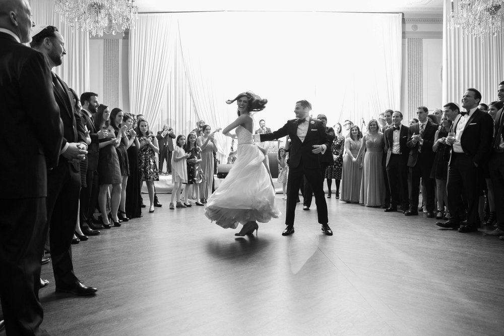 Bride and groom performing a spin during their first dance