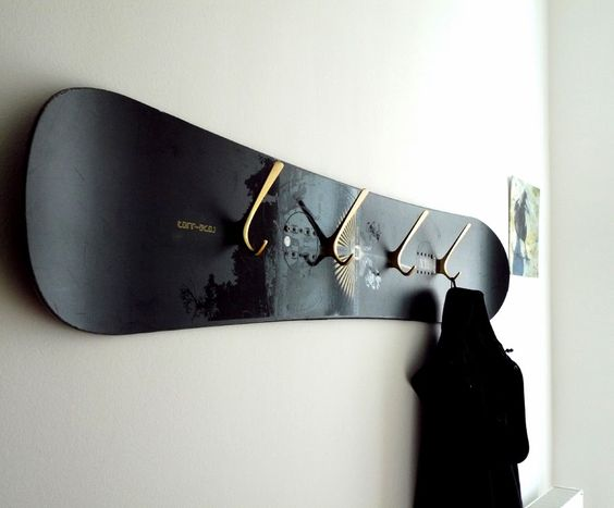 Snowboard coat rack