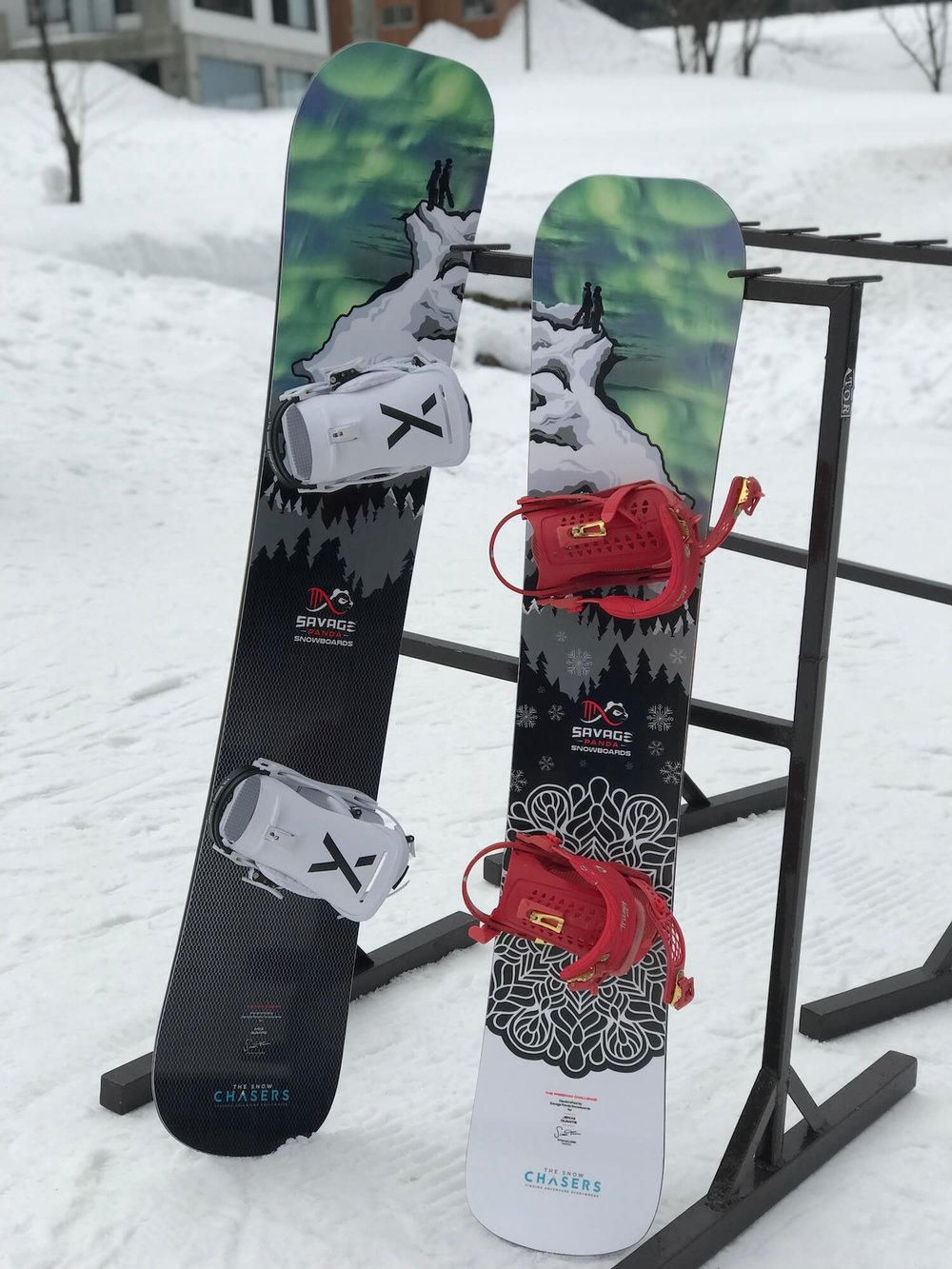 Savage Panda and The Snow Chasers snowboards on rack