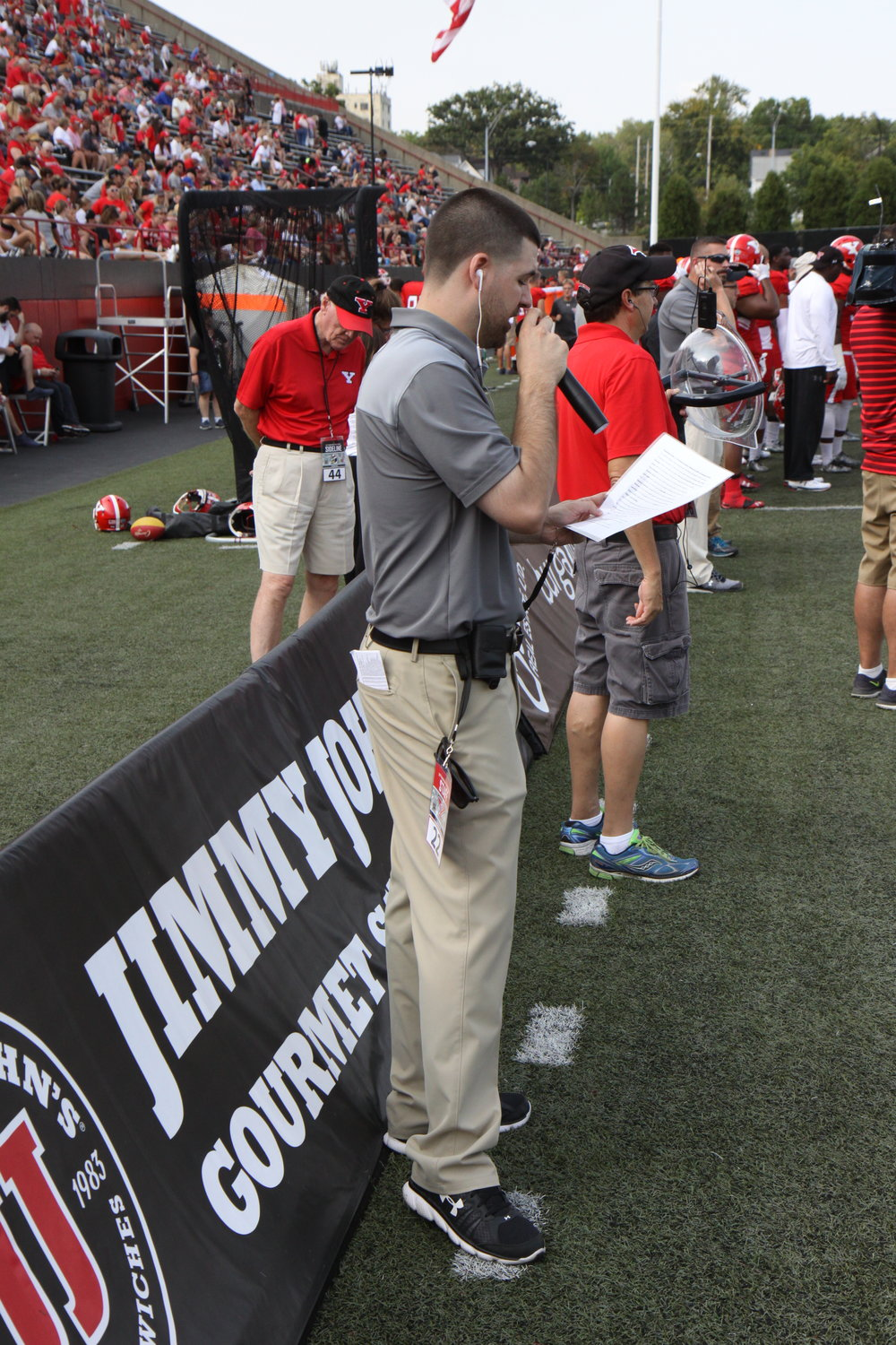 Reporting from the sidelines during a YSU Football radio broadcast vs. Central Connecticut State on Sept. 9, 2017.
